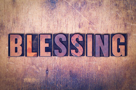 letterpress words: The word Blessing concept and theme written in vintage wooden letterpress type on a grunge background.
