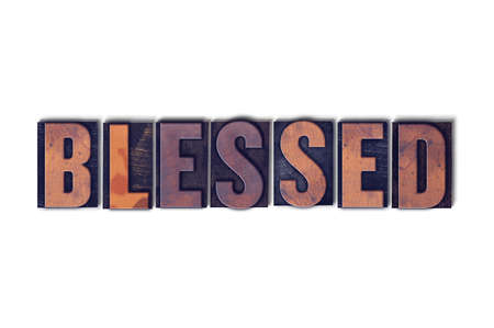 The word Blessed concept and theme written in vintage wooden letterpress type on a white background. Stock Photo