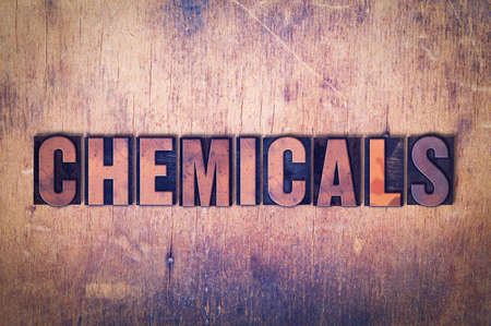 letterpress words: The word Chemicals concept and theme written in vintage wooden letterpress type on a grunge background.