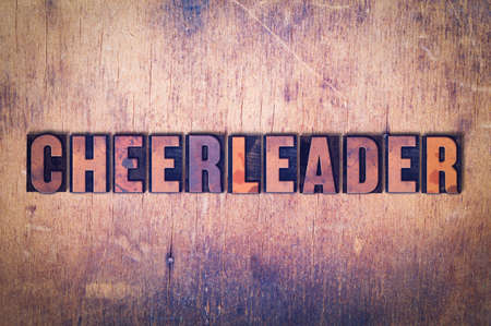 The word Cheerleader concept and theme written in vintage wooden letterpress type on a grunge background. Stock Photo