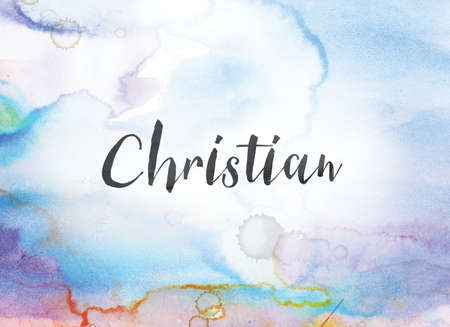 The word Christian concept and theme written in black ink on a colorful painted watercolor background. Stock Photo