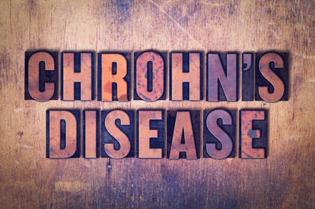 letterpress words: The words Chrohns Disease concept and theme written in vintage wooden letterpress type on a grunge background.