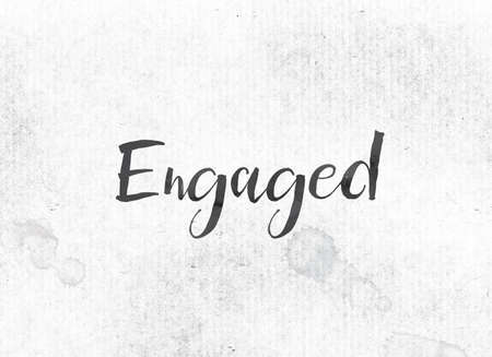 The word Engaged concept and theme painted in black ink on a watercolor wash background.