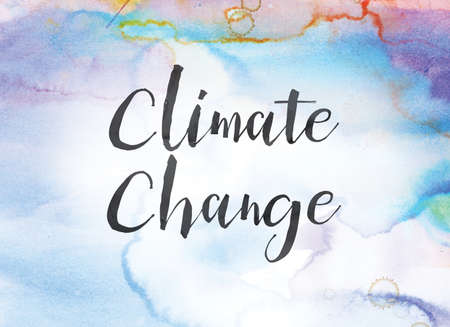 The word Climate Change concept and theme written in black ink on a colorful painted watercolor background.