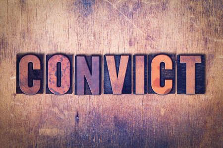 The word Convict concept and theme written in vintage wooden letterpress type on a grunge background.