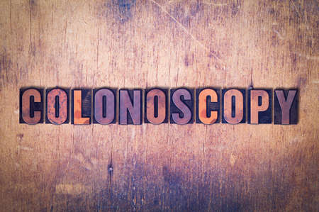 The word Colonoscopy concept and theme painted in colorful watercolors on a white paper background.