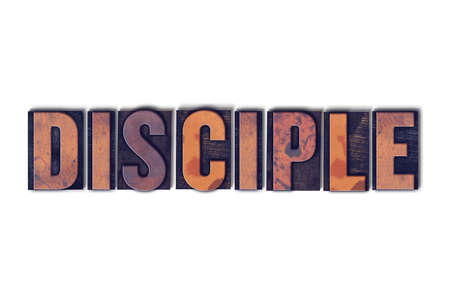 The word Disciple concept and theme written in vintage wooden letterpress type on a white background.