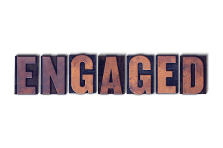 The word Engaged concept and theme written in vintage wooden letterpress type on a white background. Stock Photo