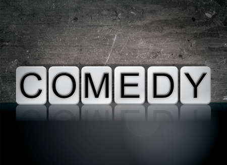hilarity: The word Comedy concept and theme written in white tiles on a dark background. Stock Photo