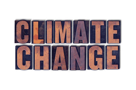 The word Climate Change concept and theme written in vintage wooden letterpress type on a white background. Stock Photo