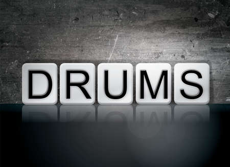 The word Drums concept and theme written in white tiles on a dark background. Stock fotó