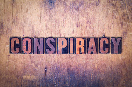 letterpress words: The word Conspiracy concept and theme written in vintage wooden letterpress type on a grunge background. Stock Photo