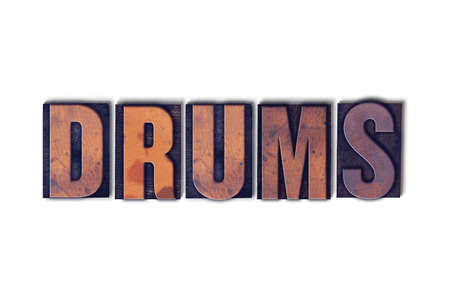The word Drums concept and theme written in vintage wooden letterpress type on a white background.