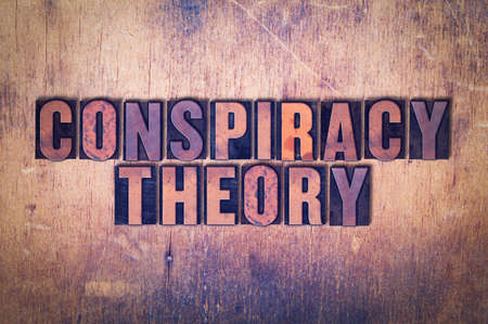 The words Conspiracy Theory concept and theme written in vintage wooden letterpress type on a grunge background.