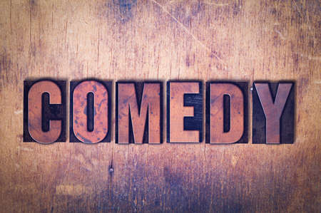 The word Comedy concept and theme written in vintage wooden letterpress type on a grunge background.