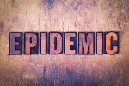 The word Epidemic concept and theme written in vintage wooden letterpress type on a grunge background.