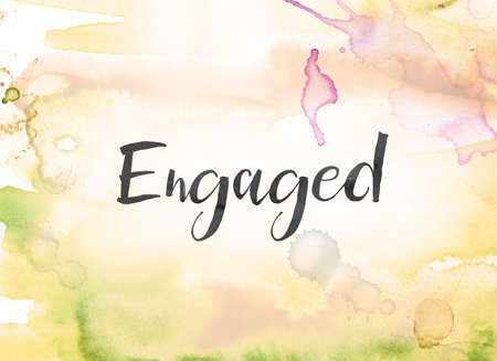 The word Engaged concept and theme written in black ink on a colorful painted watercolor background.