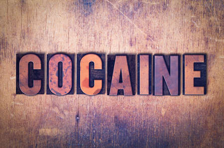 The word Cocaine concept and theme written in vintage wooden letterpress type on a grunge background.