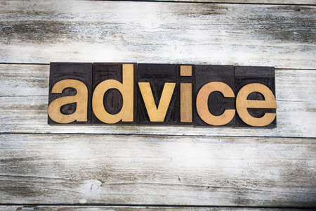 inform information: The word advice written in wooden letterpress type on a white washed old wooden boards background. Stock Photo