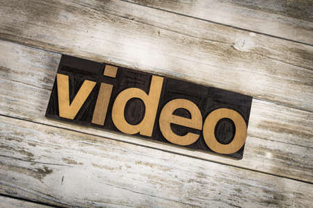 typescript: The word video written in wooden letterpress type on a white washed old wooden boards background. Stock Photo