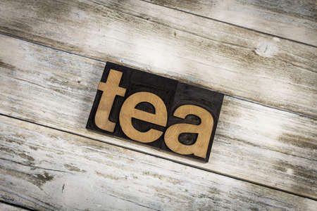 letterpress words: The word tea written in wooden letterpress type on a white washed old wooden boards background. Stock Photo