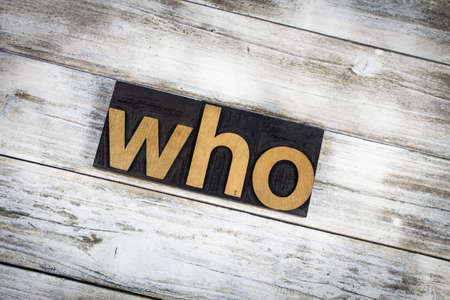 when: The word who written in wooden letterpress type on a white washed old wooden boards background. Stock Photo
