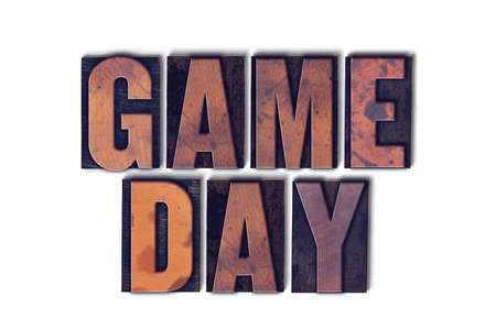 letterpress words: The words Game Day concept and theme written in vintage wooden letterpress type on a white background.
