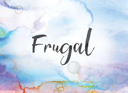 The word Frugal concept and theme written in black ink on a colorful painted watercolor background.