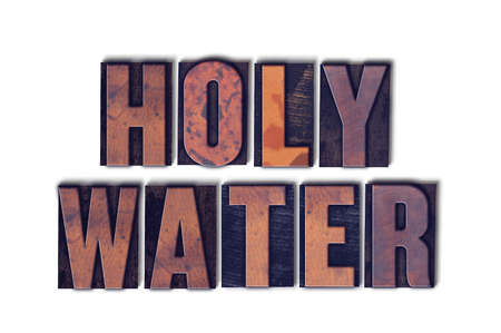 The words Holy Water concept and theme written in vintage wooden letterpress type on a white background. Stock Photo