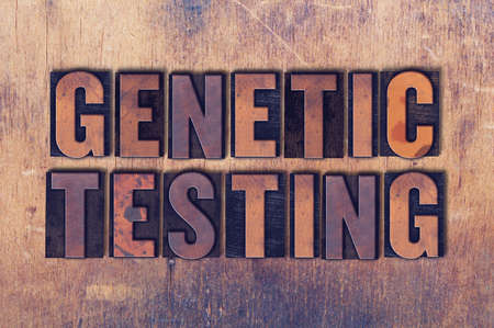 The words Genetic Testing concept and theme written in vintage wooden letterpress type on a grunge background.