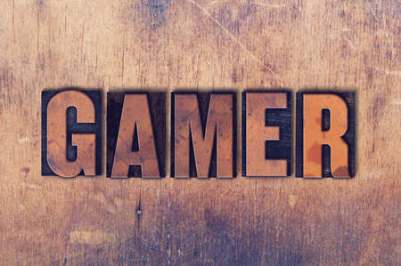 letterpress words: The word Gamer concept and theme written in vintage wooden letterpress type on a grunge background.