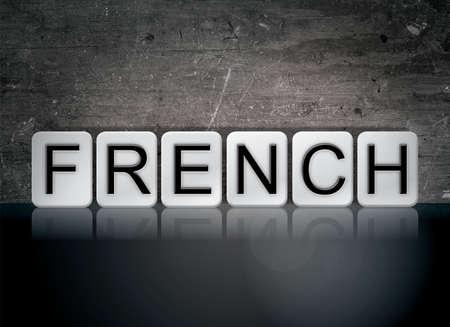 단어 프랑스어 개념 및 어두운 배경에 흰색 타일에서 작성 된 테마.