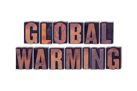 The words Global Warming concept and theme written in vintage wooden letterpress type on a white background.