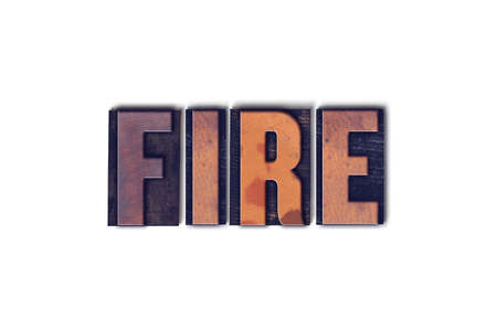 letterpress words: The word Fire concept and theme written in vintage wooden letterpress type on a white background.