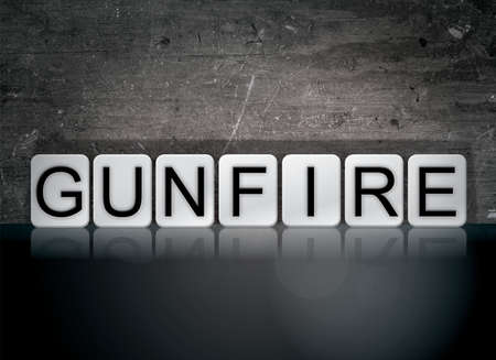 The word Gunfire concept and theme written in white tiles on a dark background.