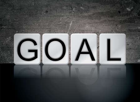 The word Goal concept and theme written in white tiles on a dark background.