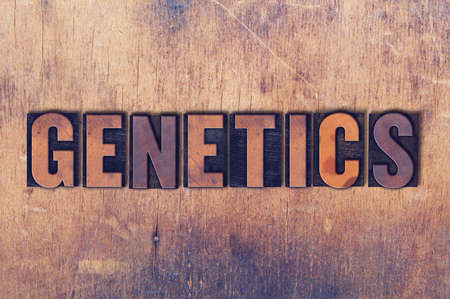 The word Genetics concept and theme written in vintage wooden letterpress type on a grunge background. 版權商用圖片