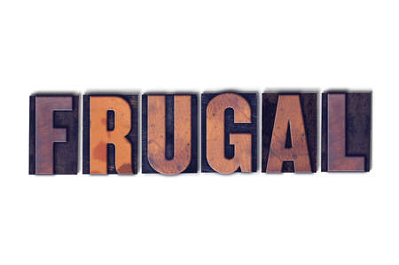 The word Frugal concept and theme written in vintage wooden letterpress type on a white background.