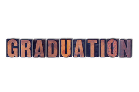 letterpress words: The word Graduation concept and theme written in vintage wooden letterpress type on a white background. Stock Photo
