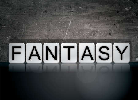 The word Fantasy concept and theme written in white tiles on a dark background. Reklamní fotografie