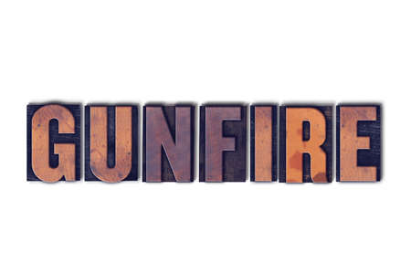 The word Gunfire concept and theme written in vintage wooden letterpress type on a white background. Stock Photo