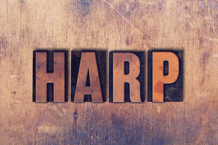 The word Harp concept and theme written in vintage wooden letterpress type on a grunge background. Stock Photo