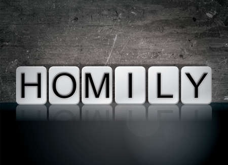 The word Homily concept and theme written in white tiles on a dark background.
