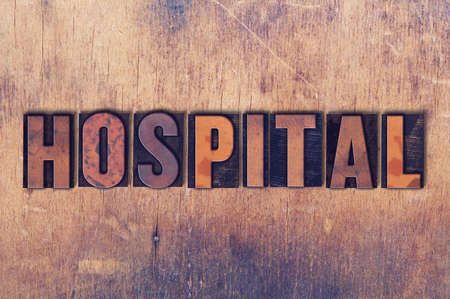 The word Hospital concept and theme written in vintage wooden letterpress type on a grunge background.