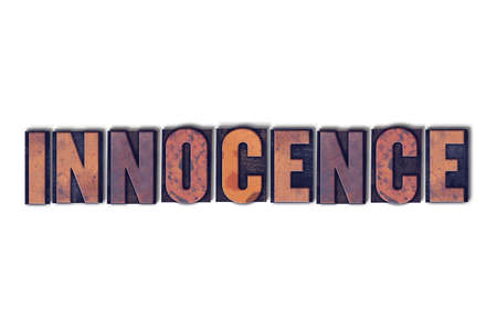 The word Innocence concept and theme written in vintage wooden letterpress type on a white background. Banco de Imagens