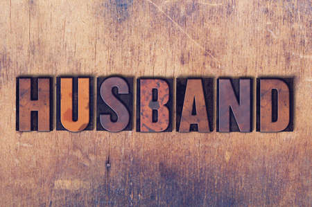 The word Husband concept and theme written in vintage wooden letterpress type on a wooden background.