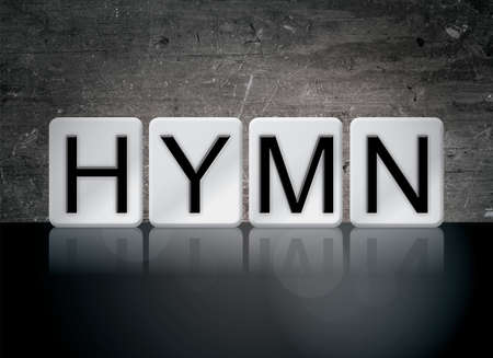 The word Hymn concept and theme written in white tiles on a dark background. Stock Photo