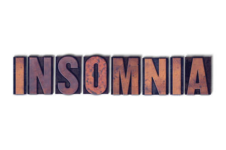 The word Insomnia concept and theme written in vintage wooden letterpress type on a white background. Фото со стока