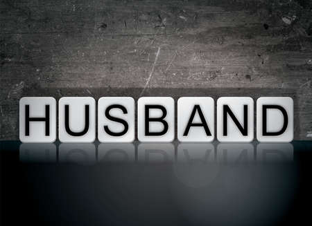 The word Husband concept and theme written in white tiles on a dark background.