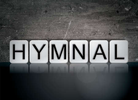 The word Hymnal concept and theme written in white tiles on a dark background. Stock Photo - 82359732